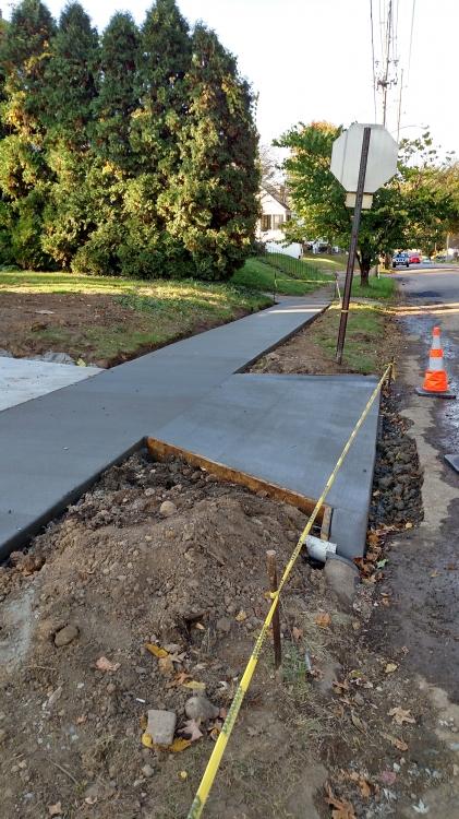 new sidewalk with driveway apron