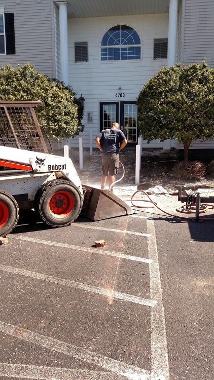 clearing more concrete with jack hammer