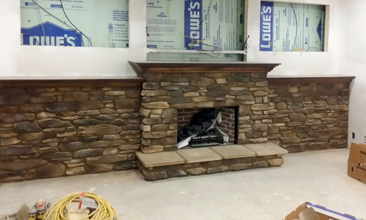 stone fireplace and wall