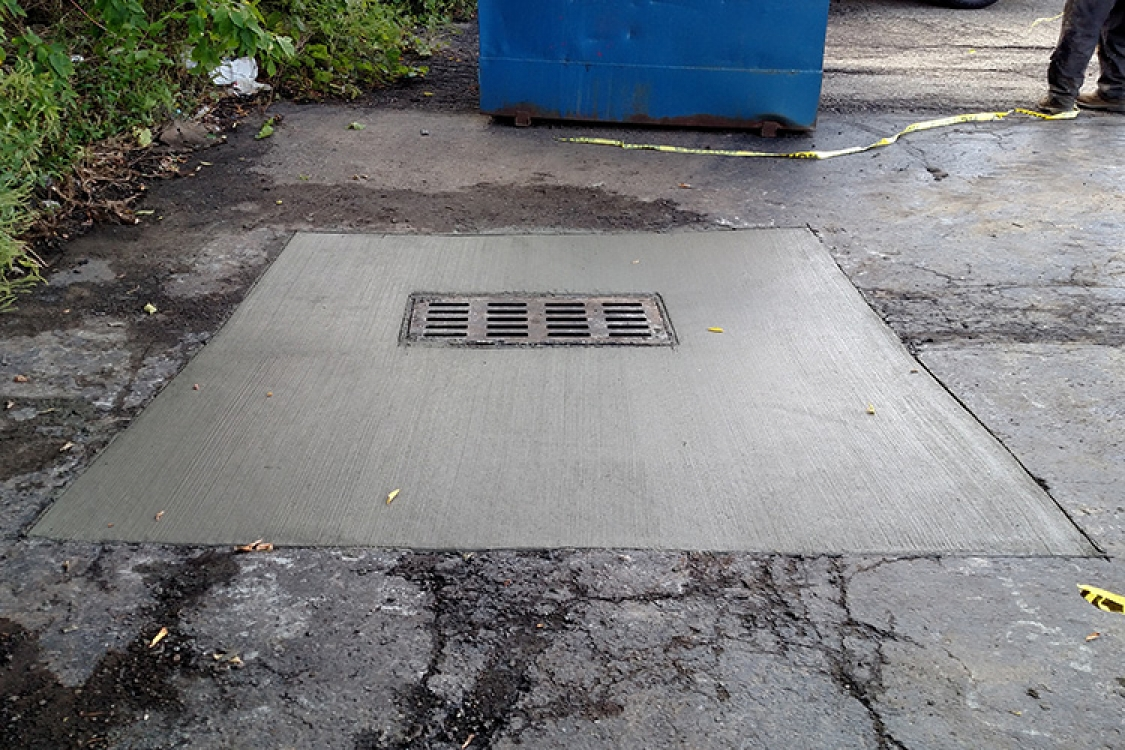 completed repair of collapsed catch basin
