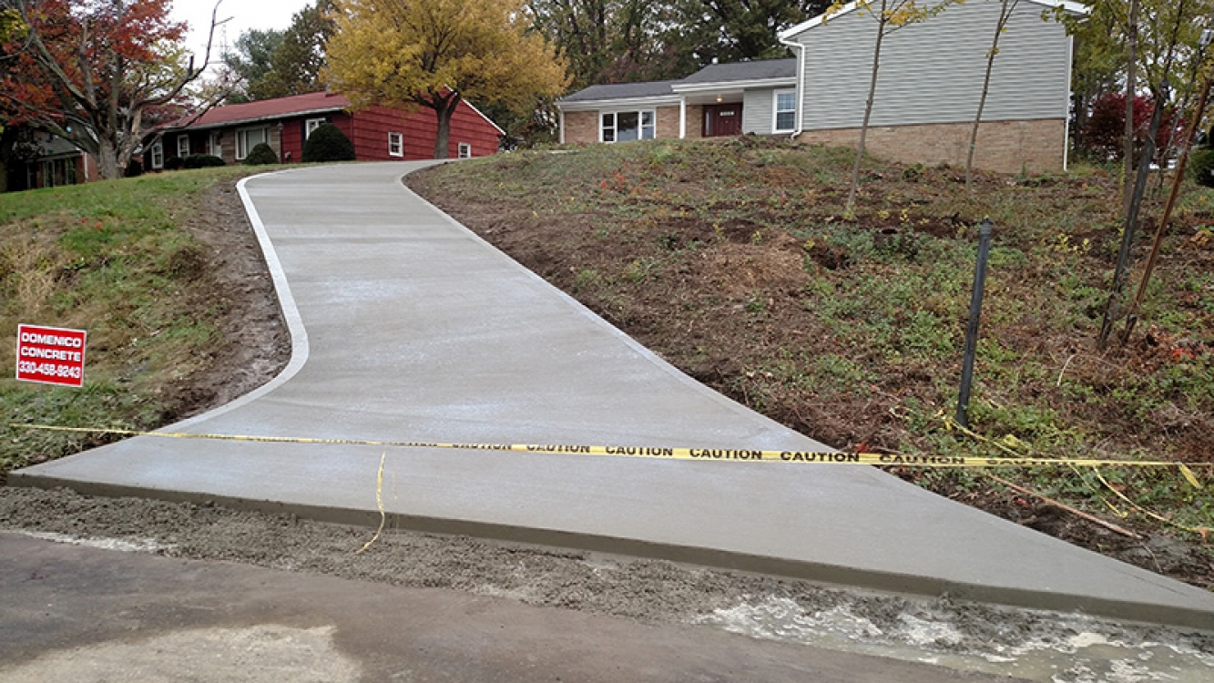 new driveway with steep grade and curve